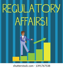 Writing note showing Regulatory Affairs. Business photo showcasing the desire of governments to protect public health Smiling Businessman Climbing Bar Chart Following an Arrow Up.