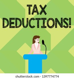 Writing note showing Tax Deductions. Business photo showcasing amount or cost that can be subtracted from someone s is income Businesswoman Behind Podium Rostrum Speaking on Microphone.