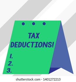 Writing note showing Tax Deductions. Business photo showcasing reduction income that is able to be taxed of expenses.