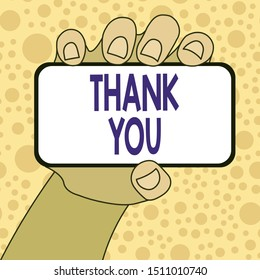 Writing note showing Thank You. Business photo showcasing a polite expression used when acknowledging a gift or service Closeup of Smartphone in Hand with Blank Screen and Text Space.