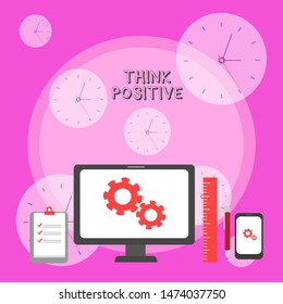 Writing note showing Think Positive. Business photo showcasing The tendency to be positive or optimistic in attitude Business Concept PC Monitor Mobile Device Clipboard Ruler Ballpoint Pen.