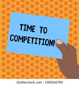 Writing note showing Time To Competition. Business photo showcasing resource and firm that make better use of minutes Drawn Hu analysis Hand Holding Blank Color Paper Cardboard.
