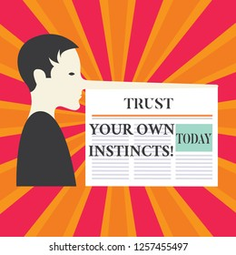 Writing note showing Trust Your Own Instincts. Business photo showcasing Intuitive follow demonstratingal feelings confidence Man with a Very Long Nose like Pinocchio a Blank Newspaper is attached.