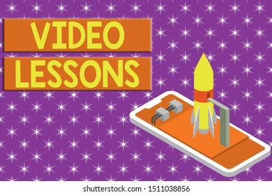 Writing note showing Video Lessons. Business photo showcasing Online Education material for a topic Viewing and learning Ready to launch rocket lying smartphone. Startup negotiations to begin.