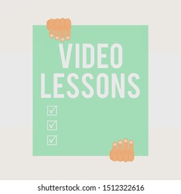 Writing note showing Video Lessons. Business photo showcasing Online Education material for a topic Viewing and learning Two hands holding big blank rectangle up down Geometrical background.