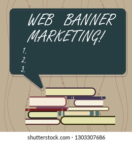 Writing note showing Web Banner Marketing. Business photo showcasing entails to embed an advertisement in a web page Uneven Pile of Hardbound Books and Rectangular Speech Bubble.