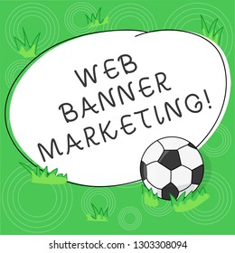 Writing note showing Web Banner Marketing. Business photo showcasing entails to embed an advertisement in a web page Soccer Ball on the Grass and Blank Outlined Round Color Shape photo.