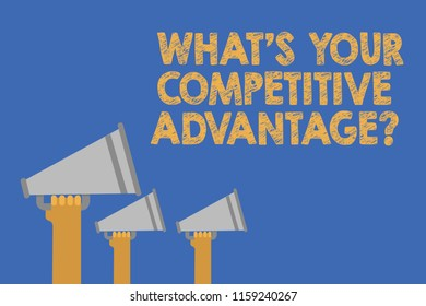 Writing note showing What s is Your Competitive Advantage question. Business photo showcasing Marketing strategy Plan Hands holding megaphones loudspeaker important message blue background.