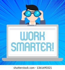 Writing note showing Work Smarter. Business photo showcasing its better to efficient and productive than waste time Man Holding and Looking into Binocular Behind Laptop Screen.
