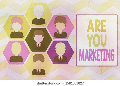 Writing note showing Are You Marketing. Business photo showcasing Actions to promote brand product Sales in market Picture frames CEO and staff Organization employee structure.