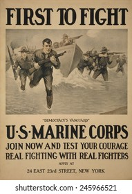 WWI. American recruiting poster showing marines storming a beach. Text reads, 'Democracy's vanguard' and 'Join now and test your courage - Real fighting with real fighters'. 1917.