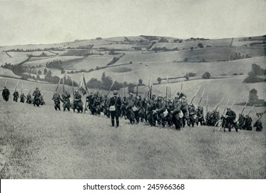 WWI. French infantry climbing a hill of the rolling country of North Eastern France. Ca. 1914-15.