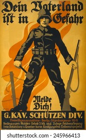 WWI. German recruiting poster depicting a German soldier, holding a grenade and a rifle; in background is a barbed wire fence and flames. 'Your Fatherland is in danger, register!' 1918