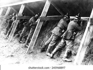 WWI German soldiers in their protected trenches on the Belgian frontier. The troops are aiming at the enemy. 1914-1918.
