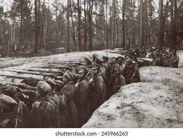 WWI. Russian forces in a trench on one of the thickly wooded plateaus in the foot hills of the Carpathians where fighting took place in their attempt to cross into Hungary. Ca. 1916-17.
