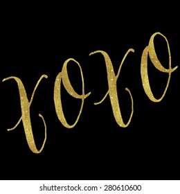 XOXO Love Gold Faux Foil Metallic Glitter Inspirational Hugs and Kisses Quote Isolated on Black Background
