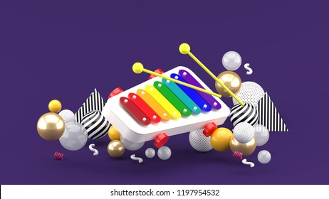 744056fbf Xylophone toy among colorful balls on purple background.-3d rendering.