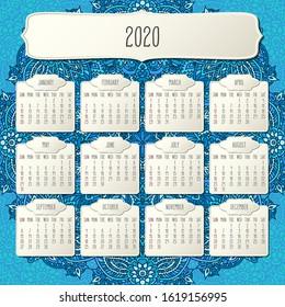 Year 2020 monthly calendar over doodle ornate hand drawn blue floral background, week starting from Sunday. Beige beveled frames design.