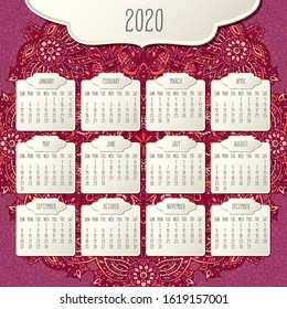 Year 2020 monthly calendar over doodle ornate hand drawn red and pink floral background, week starting from Sunday. Beige beveled frames design.