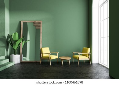 Yellow armchairs living room interior with green walls, loft windows, a concrete floor and a frame vertical mirror standing next to a potted plant. 3d rendering