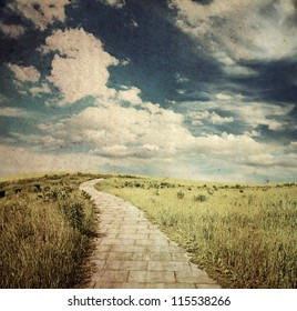 yellow brick road through fields, old fantasy grungy illustration