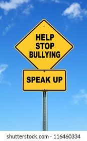 Yellow cautionary road sign, Help Stop Bullying, Speak up on blue sky background