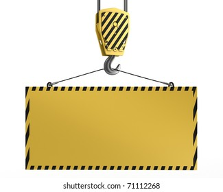 Yellow crane hook lifting blank yellow block for design purposes, isolated on white background