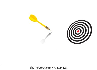 Yellow dart missed the target and hit on the white space background, Missed Target Concept