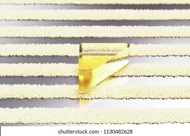 Yellow Glass Caret Left Icon on the Silver Stripe Pattern. 3D Illustration of Yellow Arrow, Back, Care, Caret, Left, Previous Icon Set With Fur Striped Silver Background.