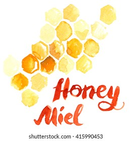 """Yellow honeycomb with lettering saying """"honey"""" and """"miel"""" painted in watercolor on white isolated background"""