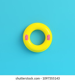 Yellow inflatable ring on bright blue background in pastel colors. Minimalism concept. 3d render