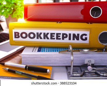 Yellow Ring Binder with Inscription Bookkeeping on Background of Working Table with Office Supplies and Laptop. Bookkeeping Business Concept on Blurred Background. 3D Render.