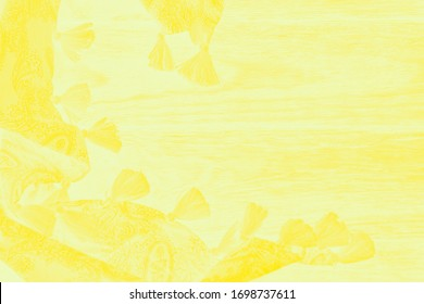 Yellow scarf with tassels on a pale yellow shabby background