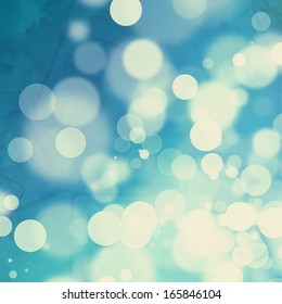 Yellowed bokeh on watercolor blue background