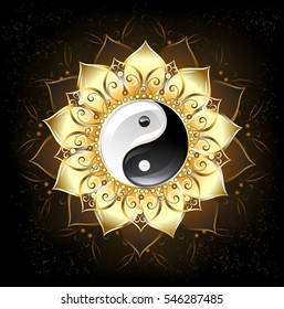 Yin yang symbol , drawn in middle of lotus with golden petals on black background.