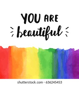 """You are beautiful"". Inspirational Gay Pride poster with watercolor rainbow spectrum flag, brush lettering. Homosexuality emblem. LGBT rights concept."