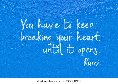 You have to keep breaking your heart until it opens - ancient Persian poet and philosopher Rumi quote printed over blue brush strokes