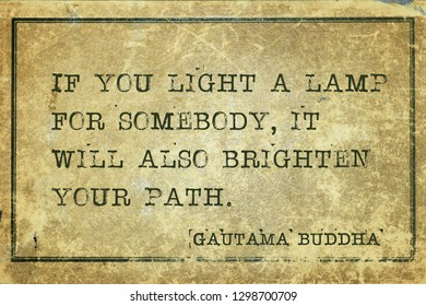 If you light a lamp for somebody, it will also brighten your path - famous quote of Gautama Buddha printed on grunge vintage cardboard