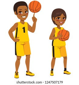 Young basketball African American children players standing with ball