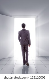 young man walking towards open door showing opportunity