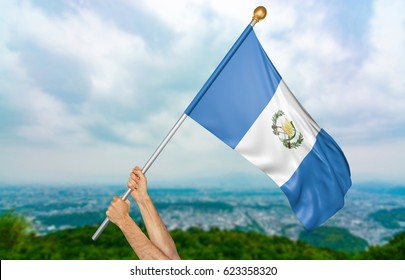 Young man's hands proudly waving the Guatemala national flag in the sky, part 3D rendering