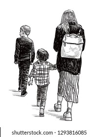 A young mother with her kids going on a stroll