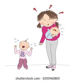 Young mother holding little crying baby girl, her second child, little toddler is standing, screaming, having temper tantrum