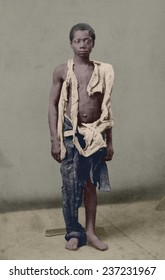Young slave during the US Civil War clothed in rags. Ca. 1963 photograph by Armstead and White with digital color.