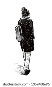 A young woman walks down the street