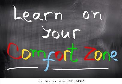 Your comfort zone handwritten on blackboard