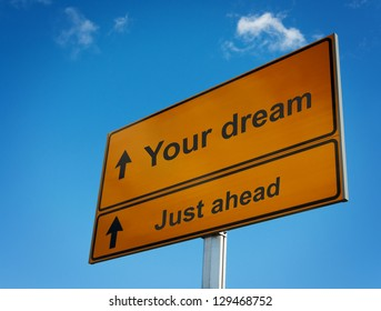 Your dream just ahead road sign. Concept of motivation and goals.