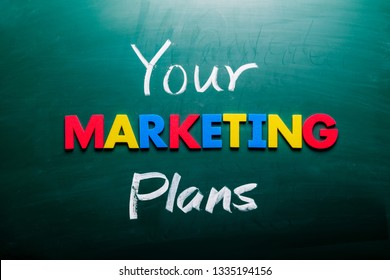 Your marketing plans concept. Colorful and handwriting words on blackboard.
