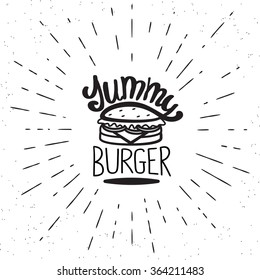Yummy burger vintage label in hipster style with sunburst. Hand drawn lettering quote on white background  for restaurants and fast food cafe posters and banners