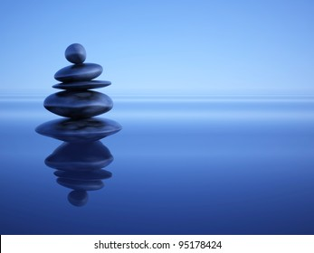 Zen stones in water under blue ambient light